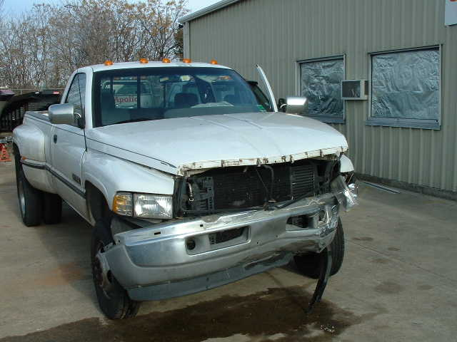 Crunch. My 1994 Dodge. Killed by a blue Chevy thing.