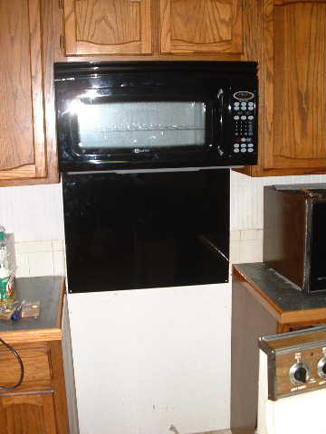 The new microwave and backsplash installed