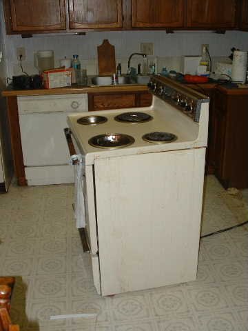 The old stove. I've pulled it out here to hang the new microwave.