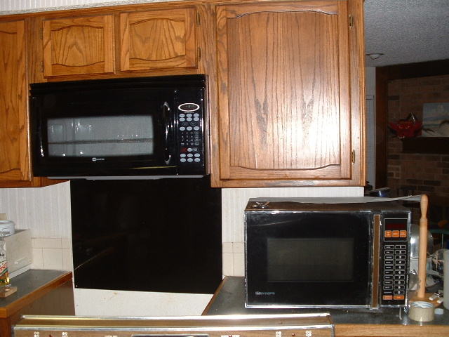 The old microwave (on the counter), and the new one installed!