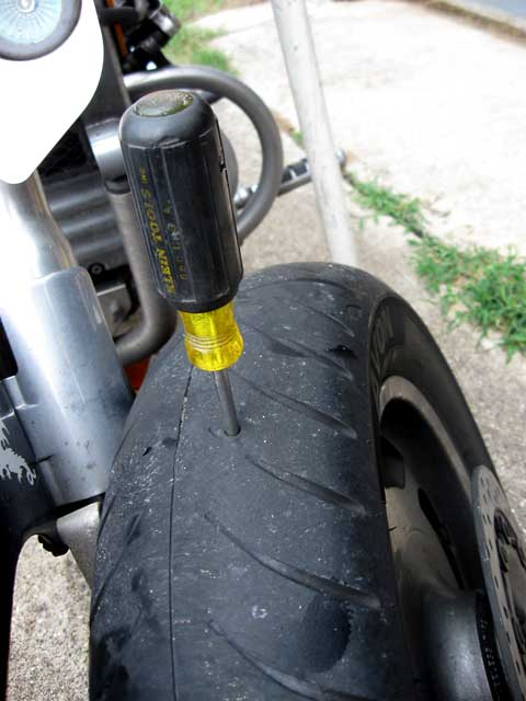 1/4 inch awl equipped tire...