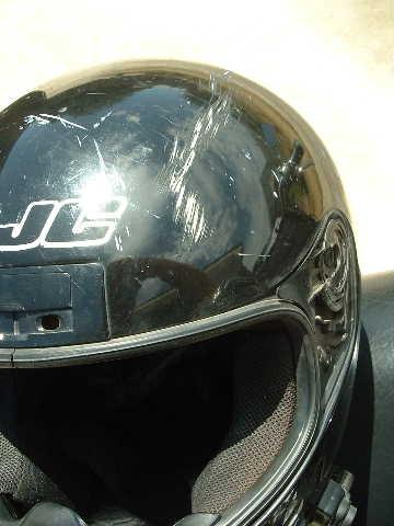 Scarred helmet.